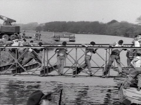 territorial army engineers clamber across a partly constructed pontoon bridge at wallingford - pontoon bridge stock videos and b-roll footage