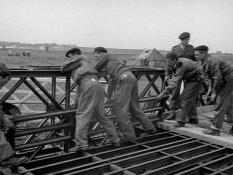 territorial army engineers lay planks on a pontoon bridge at wallingford - pontoon bridge stock videos and b-roll footage