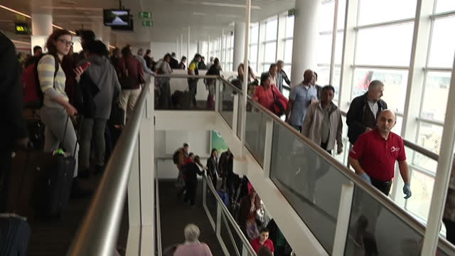 terror in brussels sky correspondent alex rossi was at the scene when the attacks happened showing interior shots people evacuating airport building... - bomb stock videos & royalty-free footage