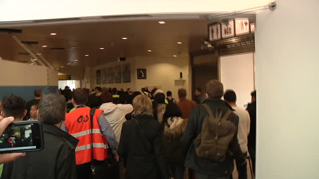 terror in brussels sky correspondent alex rossi was at the scene when the attacks happened showing interior shots crowd follow airport security... - bomb stock videos & royalty-free footage