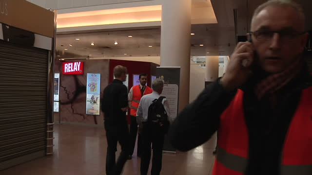 terror in brussels sky correspondent alex rossi was at the scene when the attacks happened showing interior shots distressed passengers in airport... - airline check in attendant stock videos & royalty-free footage