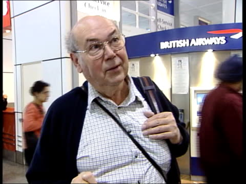 More security alerts at British airports ITN ENGLAND Surrey Gatwick Airport Two armed police along at airport PAN MS Rifle held by police officer...