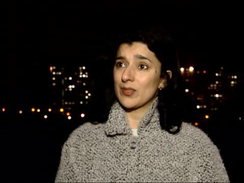 terrorism & asylum seekers link: david blunkett statement on dangers; itn scotland: glasgow: sighthill: robina qureshi along illuminated city skyline... - david blunkett stock videos & royalty-free footage