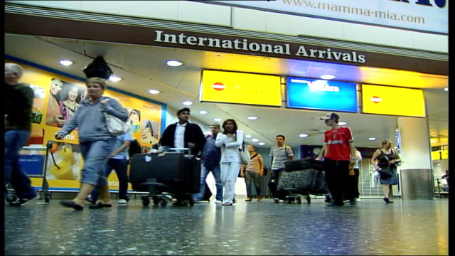 Bomb blasts at holiday resorts holidaymakers return to Gatwick ENGLAND Gatwick Airport INT Vars British holidaymakers returning from Turkey through...
