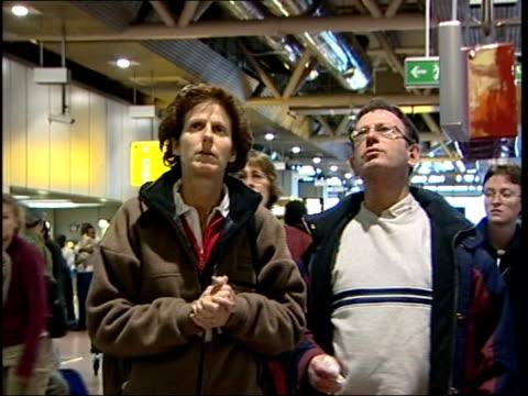 terrorism fears halt uk flights to kenya news london heathrow airport passenger display board showing flight to nairobi cancelled pan check in... - terrorism stock videos & royalty-free footage