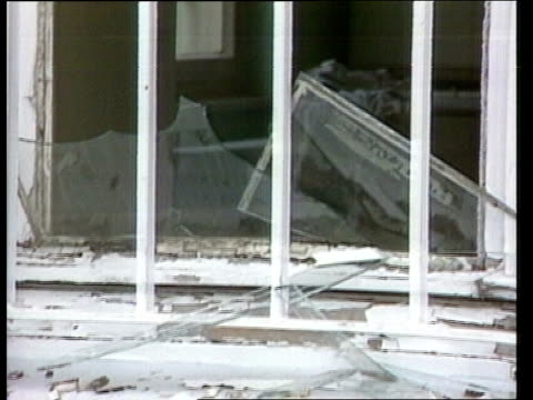 terrorism: ira men arrested; dusseldorf lms barracks building with damaged roof ) roy zoom in ) barracks barracks building with damaged roof as ) tx... - terrorismus stock-videos und b-roll-filmmaterial