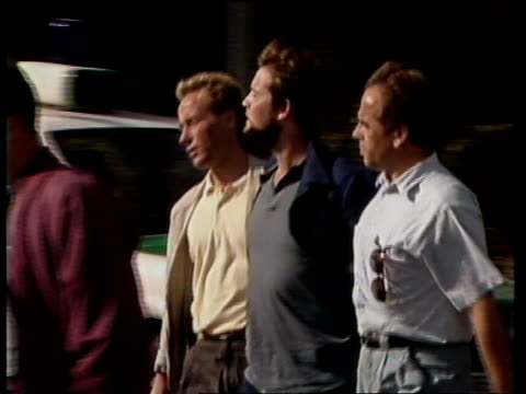 terrorism: ira men arrested; west germany, heinsberg gerard thomas hanratty flanked by 2 police escorts r-l as along into bv terrence gerard mcgeough... - 西ドイツ点の映像素材/bロール