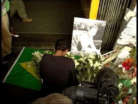 jean charles de menezes shooting police officers may face charges itn lib stockwell station ext friend of jean de menezes praying at makeshift shrine... - makeshift stock videos & royalty-free footage