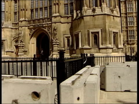 warns of terror threat to britain; itn london: westminster: ext gv concrete blocks forming barricade outside houses of parliament pull & home office:... - barricade stock videos & royalty-free footage