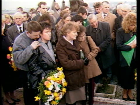 terrorism: milltown cemetery murders trial; northern ireland: terrorism: milltown cemetery murders trial; milltown cbv mourners lower coffin into... - cemetery stock videos & royalty-free footage