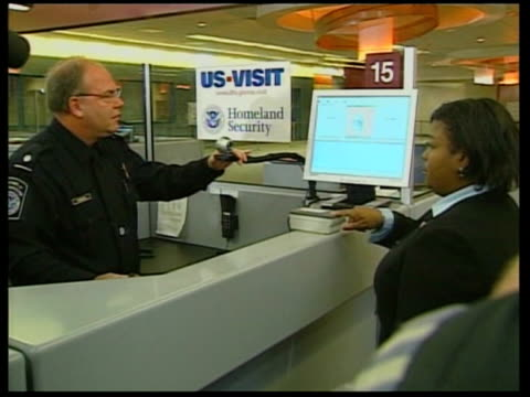 New checks on passengers arriving in the USA ITN Washington Dulles Airport CS Finger being scanned Ditto i/c