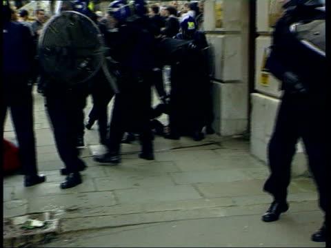 New laws come into force LIB BV Police in riot gear restraining screaming protestor BV Riot police dragging protestor along