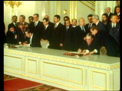 vídeos de stock e filmes b-roll de russians kidnapped in beirut cms pres assad seated talking smiling s17883 upitn ms assad seated at meeting with leonid s111080 brezhnev as they sign... - leonid brezhnev