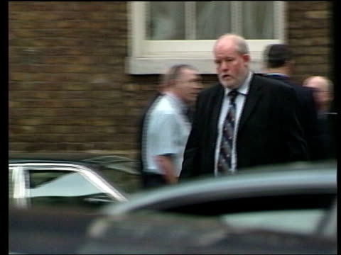 seven algerian men detained in dawn raids; file / tx 26.7.05 england: london: downing street: ext charles clarke mp along to no.10 - charles clarke uk politician stock videos & royalty-free footage