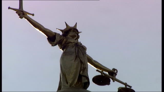 seven men on trial over suspected bomb plot old bailey low angle shots of scales of justice statue prison van leaving court pull and pan clean feed... - equal arm balance stock videos and b-roll footage