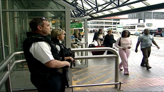 home secretary confirms 'it is highly likely' there will be another attempt tx london heathrow airport close up of hand holding police gun side view... - 2006 個影片檔及 b 捲影像