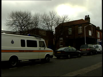 terrorist arrests in north east england; itn england: stockton: ext / night i/c darlington: day police van parked in residential road forensic... - darlington north east england stock videos & royalty-free footage