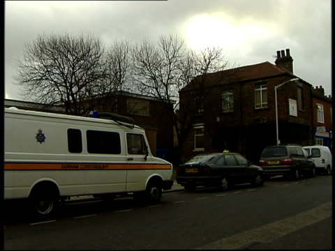 terrorist arrests in north east england itn stockton i/c darlington day police van parked in residential road forensic officers in overalls along to... - darlington north east england stock videos & royalty-free footage