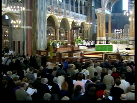 memorial services; sky pool england: london: westminster cathedral: int gvs memorial service in remembrance of victims of us terrorist attacks - westminster cathedral stock videos & royalty-free footage