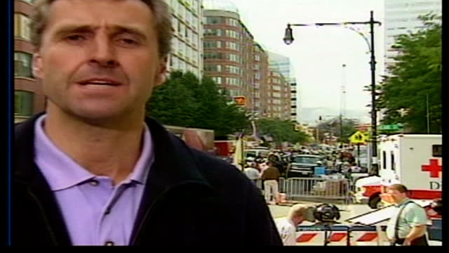 one week on; itn usa: new york: ext i/c police officer putting up 'wanted dead or alive' poster featuring osama bin laden wanted poster fixed to... - september 11 2001 attacks stock videos & royalty-free footage