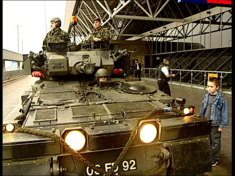 airport security itn london heathrow airport ms soldier sitting in hatch of scimitar armoured personnel carrier scimitar outside airport ms soldiers... - armoured personnel carrier stock videos & royalty-free footage