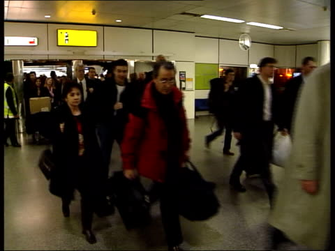 arrests at gatwick and heathrow itn passengers entering north terminal gv passengers along thru north terminal tms police car on duty on airport... - terrorism stock videos & royalty-free footage