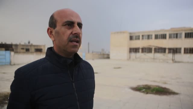 pkk terrorists shut down schools to turn them into military bases in the syrian district of tal abyad vail hamdo head of local council told anadolu... - military recruit点の映像素材/bロール