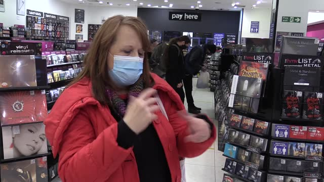 terry doyle, manager of hmv in manchester's arndale centre talks about record buyers returning to the store after being unable to browse stores for... - プラスキー点の映像素材/bロール