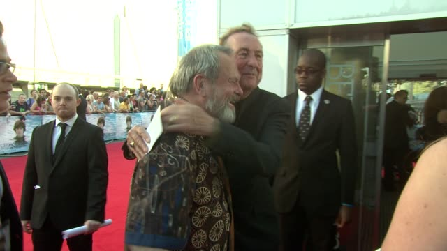 stockvideo's en b-roll-footage met terry gilliam and eric idle at the george harrison living in the material world uk premiere at london england - terry gilliam