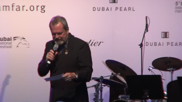 vídeos y material grabado en eventos de stock de terry gilliam auctions a trip to asia at the 2008 dubai international film festival amfar auction and dinner at dubai . - terry gilliam