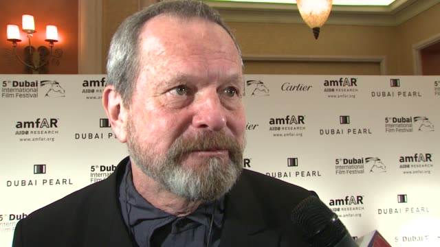 stockvideo's en b-roll-footage met terry gilliam on getting his lifetime award tonight on worrying about his hernia carrying it back on the medal he's wearing at the 2008 dubai... - terry gilliam