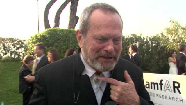 terry gilliam on how he acquired his accessory. at the cannes film festival 2009: amfar red carpet at antibes . - terry gilliam stock videos & royalty-free footage