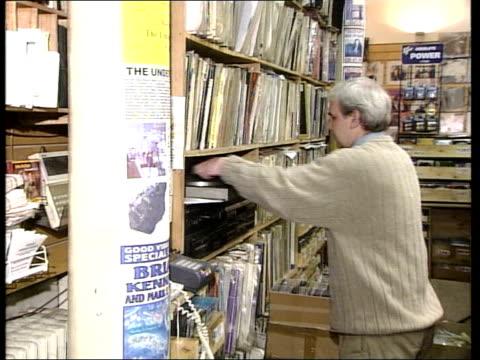vídeos y material grabado en eventos de stock de terry hooley putting album on record player in shop zoom in record spinning as 'teenage kicks' by the undertones plays sot terry hooley interviewed... - the undertones