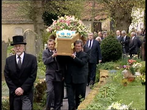 buckinghamshire cuddington st nicholas church coffin of terry lloyd carried towards through churchyard followed by family and friends mourners along... - mourner stock videos and b-roll footage