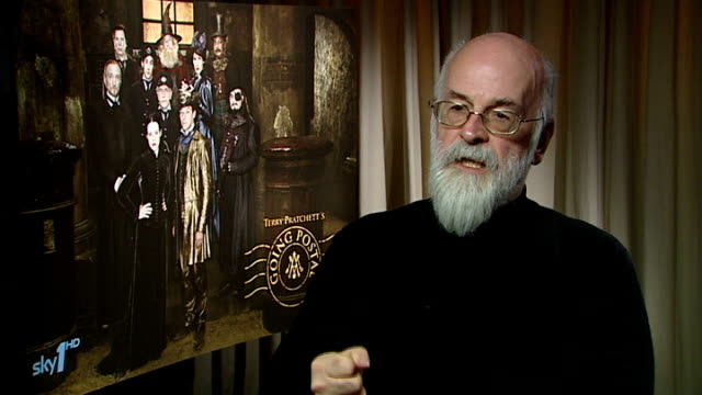 terry pratchett interview pratchett interview sot on people losing sight of how wonderful technology is / quotes wh auden poem 'the night mail' / we... - postal stamp stock videos and b-roll footage