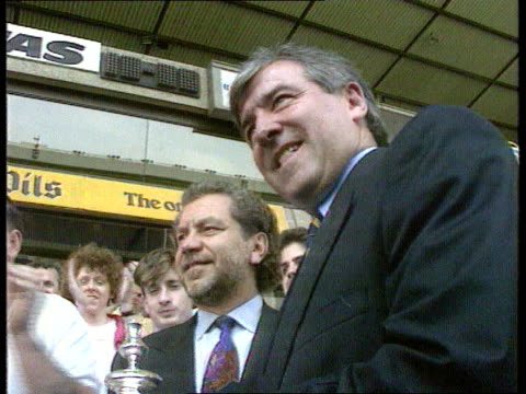 terry venables sacked ext cms cup held tilt up alan sugar standing smiling with venables tgv mass of vans welcoming spurs team on open top bus tilt... - alan sugar stock videos and b-roll footage