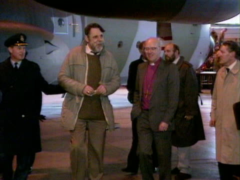 terry waite and george carey, the archbishop of canterbury walk through a hangar at raf lyneham following terry waite's return home after years of... - archbishop of canterbury stock videos & royalty-free footage