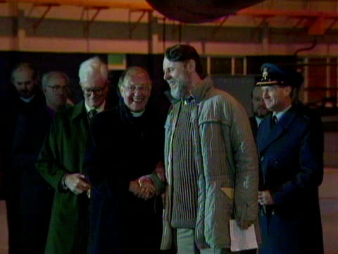 terry waite shakes hands with robert runcie and douglas hurd at raf lyneham after returning home from his years of captivity in beirut. november 1991. - robert runcie stock videos & royalty-free footage