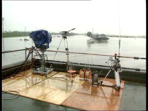 Terry Waite's homecoming ENGLAND London RAF Lyneham BV Press on platform wearing anoraks LAMS Camera tripods and rain soaked press on platform CMS...