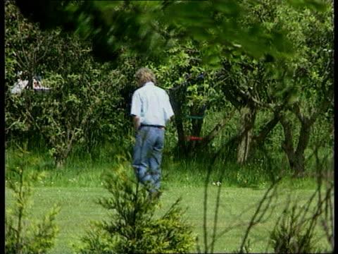 terry yorath's son daniel dies; england leeds lbv terry yorath along in garden - leeds stock videos & royalty-free footage