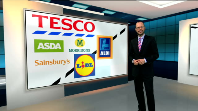 stockvideo's en b-roll-footage met tesco accounting scandal: chairman sir richard broadbent to resign; england: london: int reporter to camera at video wall dave lewis interview sot... - voorzitter
