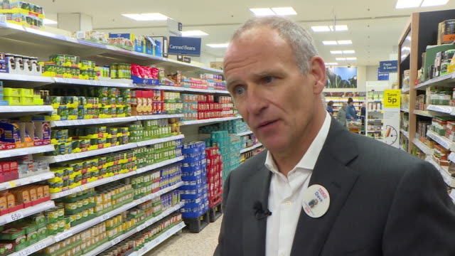 tesco chief executive dave lewis saying customers will have to get used to not having multipack wrapping as it scrapped to prevent plastic waste - concepts stock videos & royalty-free footage