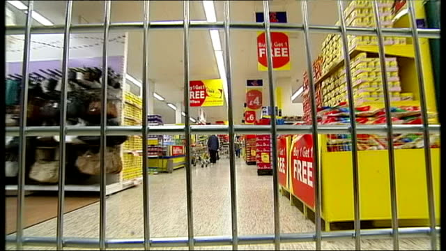 tesco chief executive unveils overhaul england shot povs from supermarket trolley as along aisles of tesco supermarket checkout till sin tesco... - hanging sign stock videos and b-roll footage