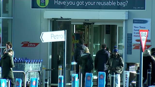 vídeos y material grabado en eventos de stock de tesco extra store in wembley; england: london: wembley: ext sign 'tesco extra' / sign 'tesco extra' on roof of supermarket / car park / exterior of... - bare tree