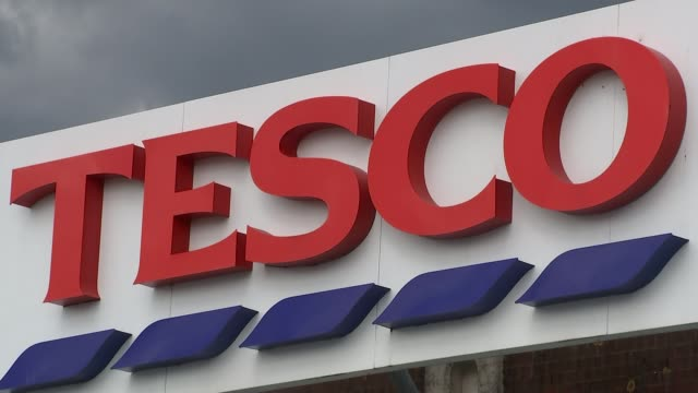 tesco fined after accounting scandal lib / 1342016 surrey quays ext sign 'tesco' poster 'rewarding you' on wall various shots of poster 'great value'... - poster wall stock videos & royalty-free footage