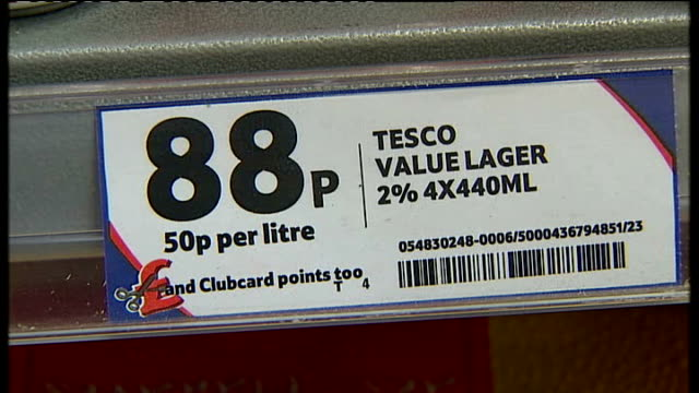 tesco give evidence to mps over alcohol selling t21020843 int close shot price label for tesco value lager close shot of can of tesco value lager - lager stock videos & royalty-free footage