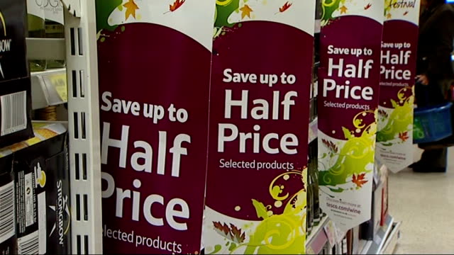 tesco supermarket to cut price of groceries england int 'save up to half price' sign on aisle 'special purchase' sign on parsnips price reduction... - 生鮮食品コーナー点の映像素材/bロール