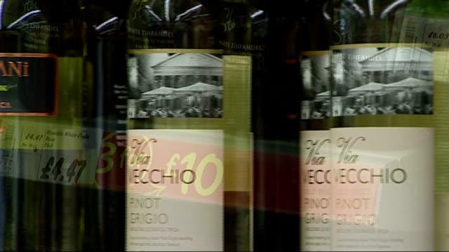 tesco value lager on supermarket shelves botlles of wine on supermarket shelves - lager stock videos & royalty-free footage