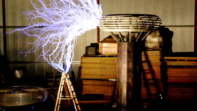 tesla coil discharge, high-speed footage - tesla coil stock videos and b-roll footage