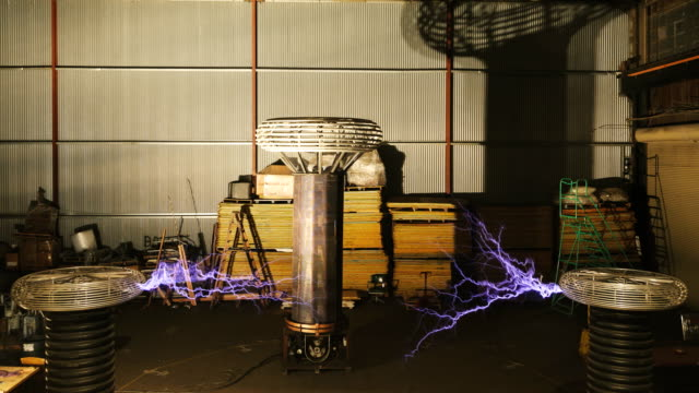 tesla coil discharges, high-speed footage - tesla coil stock videos and b-roll footage